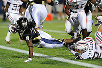 5 December 2009:  FIU running back Daunte Owens (8) stretches out for a touchdown in the second quarter as the Florida Atlantic University Owls defeated the FIU Golden Panthers, 28-21, in the annual Shula Bowl game at FIU Stadium in Miami, Florida.