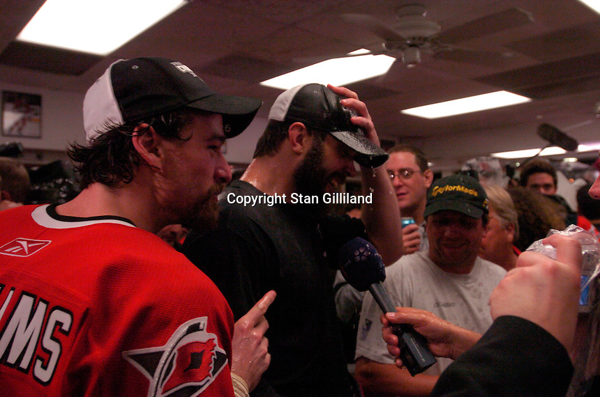 Justin Williams speaks with reporters having just poured champagne on teammate Niclas Wallin in the locker room. The Carolina Hurricanes beat the Edmonton Oilers 3-1 in game seven to take the Stanley Cup at the RBC Center in Raleigh, NC Monday, June 19, 2006.