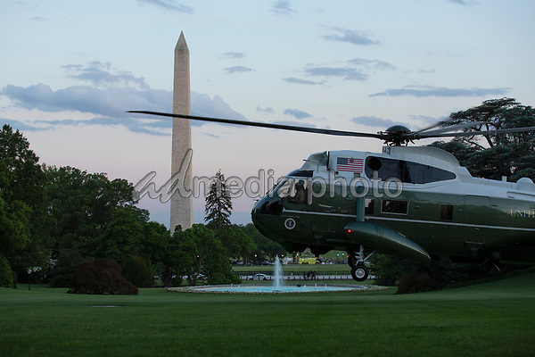 """Marine One, carrying United States President Donald J. Trump, approaches the South Lawn of the White House in Washington, D.C., U.S., as he arrives from the Kennedy Space Center in Florida on Saturday, May 30, 2020.  Trump vowed his administration would end what he called """"mob violence"""" in U.S. cities following the death of an unarmed black man at the hands of Minnesota police, blaming leftist groups for clashes with police and property damage around the nation. <br /> Credit: Stefani Reynolds / Pool via CNP/AdMedia"""