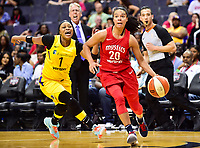 Washington, DC - June 15, 2018: Washington Mystics guard Kristi Toliver (20) drives by Los Angeles Sparks guard Odyssey Sims (1) on her way to the basket during game between the Washington Mystics and Los Angeles Sparks at the Capital One Arena in Washington, DC. (Photo by Phil Peters/Media Images International)