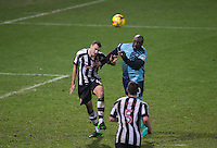 Adebayo Akinfenwa of Wycombe Wanderers goes up against Haydn Hollis of Notts Co during the Sky Bet League 2 match between Notts County and Wycombe Wanderers at Meadow Lane, Nottingham, England on 10 December 2016. Photo by Andy Rowland.