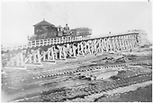 D&amp;RG engine pushing a loaded coal car up the Alamosa coaling trestle.<br /> D&amp;RG  Alamosa, CO  Taken by Davis, O. T. - ca. 1897-1899