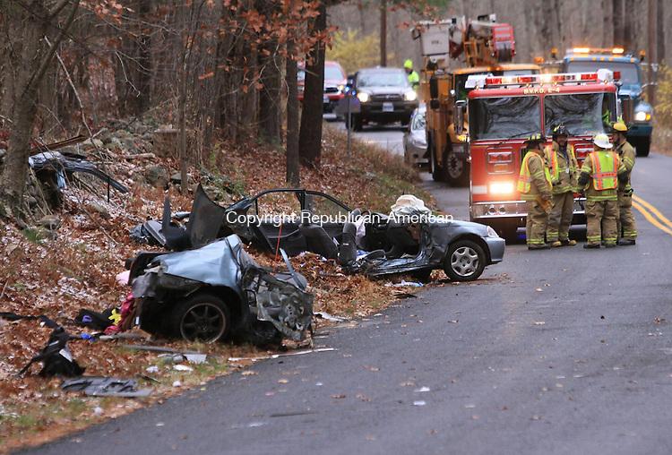 A Honda split in two Tuesday morning following a crash on Alian White Road in Morris.  JOHN MCKENNA/ REPUBLICAN-AMERICAN