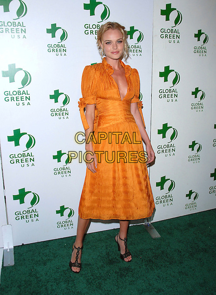KATE BOSWORTH.Attends Global Green USA's Annual Oscar Party held at The Henry Fonda Music Box Theatre in Hollywood, California, USA, March 3rd 2006..full length orange dress black t-bar shoes.Ref: DVS.www.capitalpictures.com.sales@capitalpictures.com.©Debbie Van Story/Capital Pictures