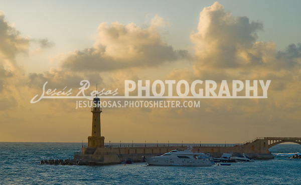 A lighthouse in Alexandria during a sunset. Alexandria, Egypt. Year: 2009.