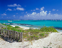 Anguilla, BWI<br /> Weathered fence on the beach dunes and turquoise waters of Upper Shoal Bay, Caribbean Sea