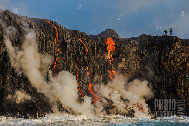 Photographers catch images of lava cascading into the ocean near Kalapana on the Big Island of Hawai'i.