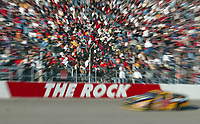 A car races down the frontstretch during the Pop Secret 400 NASCAR Winston Cup race at Rockingham, NC on Sunday, November 9, 2003. (Photo by Brian Cleary)