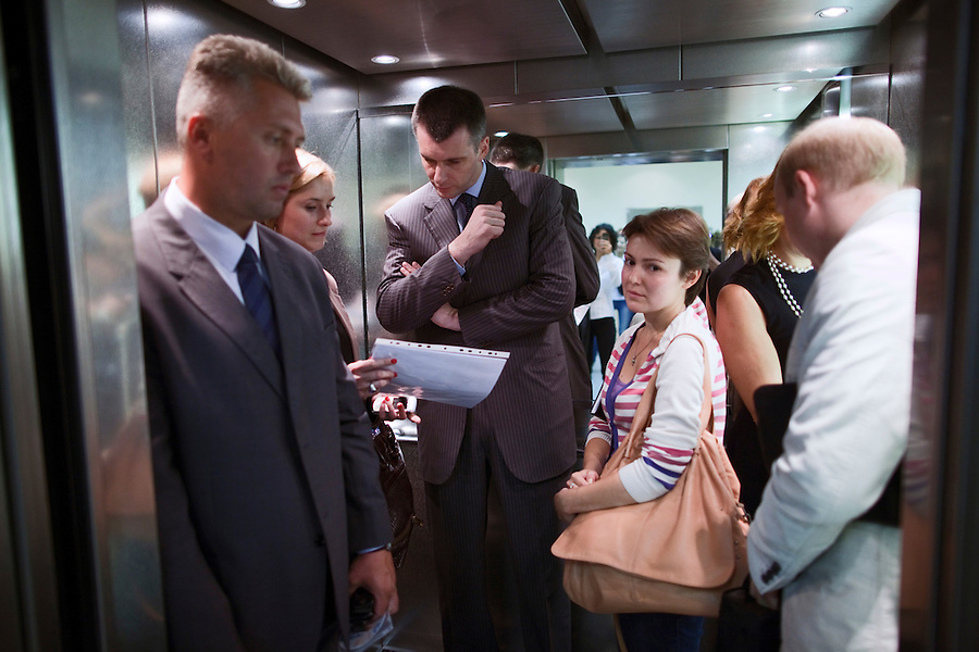Moscow, Russia, 06/09/2011..Russian billionaire businessman Mikhail Prokhorov, newly elected leader of pro-business political party Right Cause, with security and assistants as he leaves a meeting at the Economics Faculty of the Moscow State University.