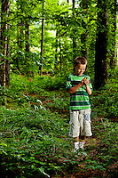 """Visitors to the US National Whitewater Center in Charlotte NC explore the center's geocaching program. Geocatching uses GPS devices to hunt treasures. The USNWC geocaches are """"eco-caches,"""" which focus on providing environmental education to participants."""