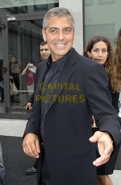 GEORGE CLOONEY.Armani's Spring-Summer 2007 men's collection, during Milan's fashion shows, Milan, Italy..June 28th, 2006 .Ref: OME.half length black suit jacket hand.www.capitalpictures.com.sales@capitalpictures.com.© Capital Pictures.