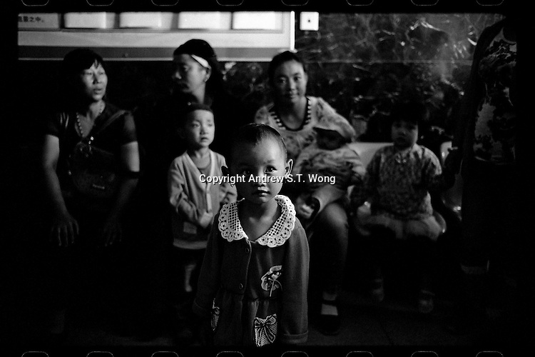 Chinese children born with clefts wait for the start of a training course and workshop before a three-day clefts operations organized by Smile Angel Foundation for the poor at hospitals in Xining, Qinghai province, China, August 2013. (Names withheld for privacy)