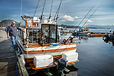 USA, Alaska, Ketchikan, the main guide and fisherman prepares the boat for a trip to the Behm Canal near Clarence Straight, Knudsen Cove along the Tongass Narrows