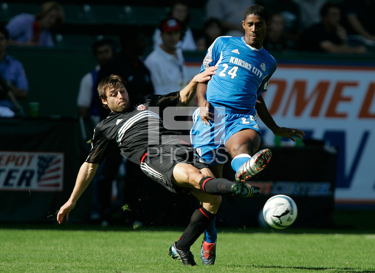 D.C. United's Dema Kovalenko, left and Kansas City Wizards' Khari Stephenson, right, battle for a ball during a  3-2 D.C. United victory at the MLS Cup, at the Home Depot Center, in Carson, Calif., Sunday, Oct. 14, 2004.