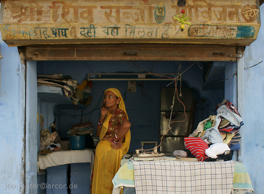 woman in Ironing shop in the streets of Jodhpur, Rajastan, India