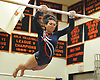 Brittney Viera of Smithtown performs on the uneven bars during the Suffolk County varsity girls' gymnastics individual championships at Babylon High School on Friday, November 6, 2015.<br /> <br /> James Escher
