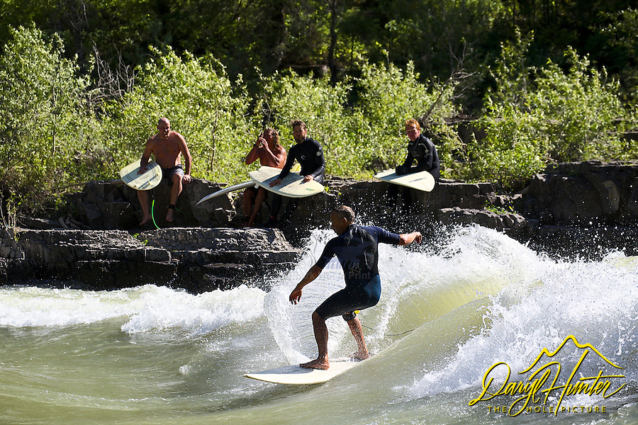 Rocky Mountain Surf Lineup. River surfers surfing Lunch Counter Rapid on the Snake River in Jackson Hole, Wyoming