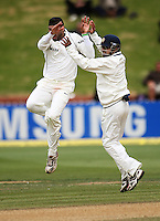 India's Gautam Gambhir (right) congratulates Harbhajan Singh on dismissing Jesse Ryder for a duck during day four of the 3rd test between the New Zealand Black Caps and India at Allied Prime Basin Reserve, Wellington, New Zealand on Monday, 6 April 2009. Photo: Dave Lintott / lintottphoto.co.nz.