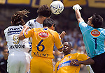 UNAM Pumas forward Marco Antonio Palacios heads the ball as UANL Tigres goalkeeper Edgar Hernandez (R) tries to block the ball, UANL defenders Omar Briseno and Julio Santos look at the scene, during their soccer match in the Mexico City's University Staduim, April 23, 2006. UNAM forward Bruno Marioni appears jumping on the scene at left. UNAM Pumas tied 1-1 to UANL Tigres. Photo by © Javier Rodriguez