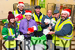 Caitlyn Roach, Alan O'Sullivan, Danny Roach, Martin O'Regan, John White, Vincent Sullivan, Tommy Neenan sorting the letters to Santa, from all the Children of Kerry