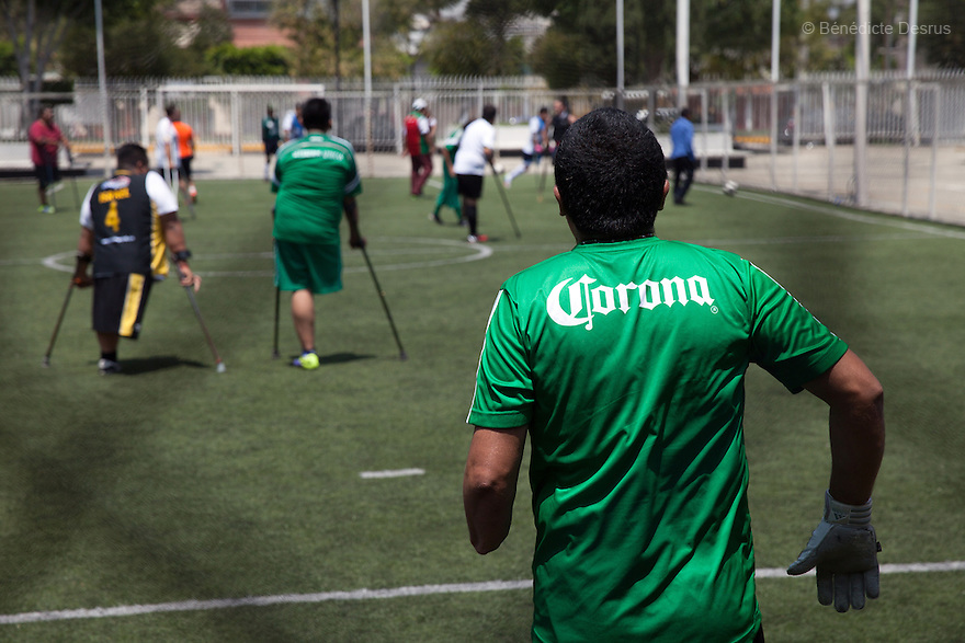Rey David Angeles Perez, the goalkeeper of Guerreros Aztecas, during a training session in Mexico City, Mexico on August 23, 2014.<br /> Rey David Angeles Perez, 46, lost his left arm in a work accident in 2012. He is currently unemployed but helps out at his sister&rsquo;s restaurant. Guerreros Aztecas (&ldquo;Aztec Warriors&rdquo;) is Mexico City&rsquo;s first amputee football team. Founded in July 2013 by five volunteers, they now have 23 players, seven of them have made the national team's shortlist to represent Mexico at this year's Amputee Soccer World Cup in Sinaloa&nbsp;this December.&nbsp;The team trains twice a week for weekend games with other teams. No prostheses are used, so field players missing a lower extremity can only play using crutches. Those missing an upper extremity play as goalkeepers. The teams play six per side with unlimited substitutions. Each half lasts 25 minutes. The causes of the amputations range from accidents to medical interventions &ndash; none of which have stopped the Guerreros Aztecas from continuing to play. The players&rsquo; age, backgrounds and professions cover the full sweep of Mexican society, and they are united by the will to keep their heads held high in a country where discrimination against the disabled remains widespread.&nbsp;(Photo by&nbsp;B&eacute;n&eacute;dicte Desrus)