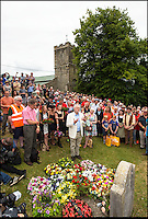 BNPS.co.uk (01202 558833)<br /> Pic: PhilYeomans/BNPS<br /> <br /> Corbyn makes a short speech at the martyrs graves.<br /> <br /> There was no escape for beleaguerd Labour leader Jeremy Corbyn even in the bucolic surroundings of the Tolpuddle Martyrs rally in the heart of Dorset.<br /> <br /> Labour Party member Claire Cavendish climbed a gravestone to deliver a vitriolic attack on the controversial leader , demanding he should step down, just after he had laid a wreath on a martyrs grave in the village churchyard.<br /> <br /> Jeremy Corbyn is a regular visitor to the famous rally that is seen as a key event in the founding of the Trade Union movement.