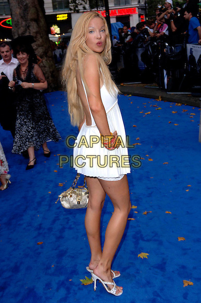 "ALICIA DOUVALL.European film premiere""Miami Vice"".Odeon cinema Leicester Square.27th July 2006 in London, England.Ref: FIN.full length white mini dress looking over shoulder.www.capitalpictures.com.sales@capitalpictures.com.©Steve Finn/Capital Pictures."