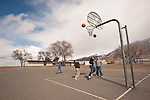 Kids play basketball on the playground during recess at the small rural Nevada school in Orovada