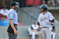 Chris Hatcher #36 of the Jacksonville Suns argues a strike call with home plate umpire Travis Carlson at Five County Stadium May 15, 2010, in Zebulon, North Carolina.  Photo by Brian Westerholt /  Seam Images