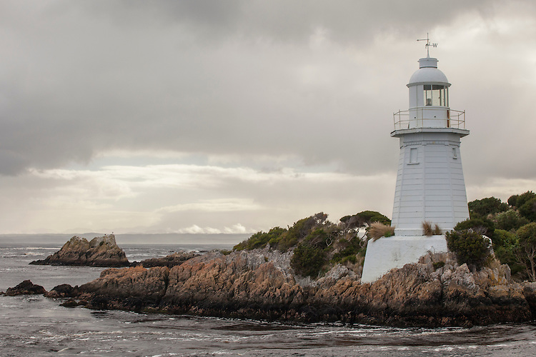 Lighthouse on Macquarie Harbour's entrance at Hells Gate on the west coast of Tasmania