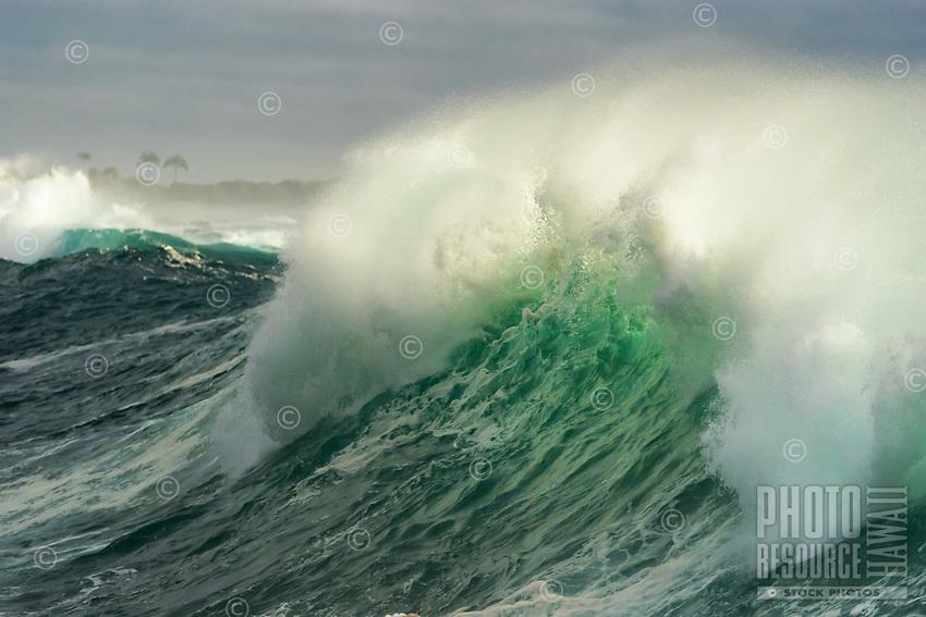 A large wave breaks during high surf along the 'O'oma coastline, near OTEC (Ocean Thermal Energy Conversion) and NELHA (National Energy Laboratory of Hawai'i Authority) facilities, Kailua-Kona, Big Island.