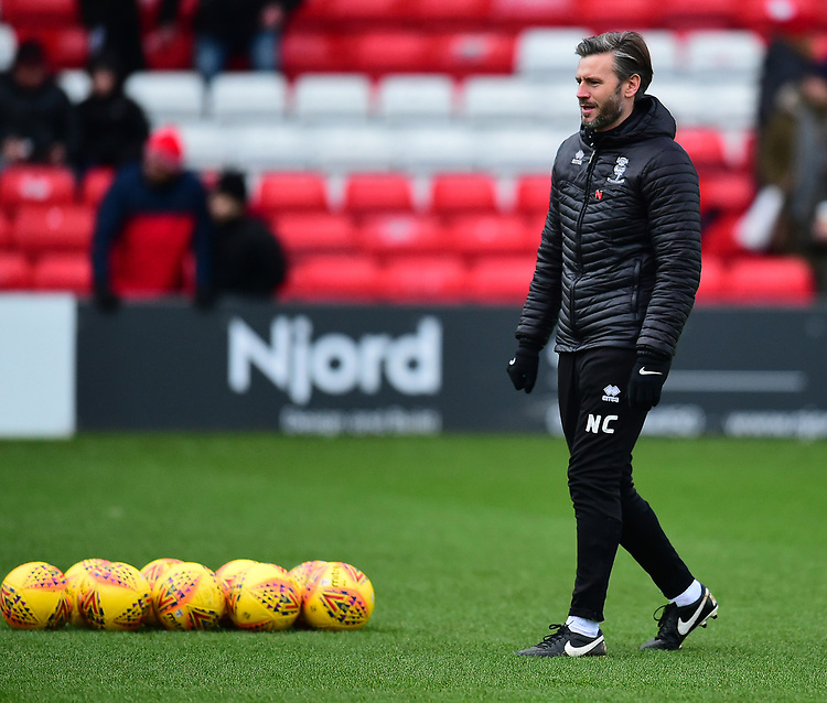 Lincoln City's assistant manager Nicky Cowley during the pre-match warm-up<br /> <br /> Photographer Andrew Vaughan/CameraSport<br /> <br /> The EFL Sky Bet League Two - Lincoln City v Grimsby Town - Saturday 19 January 2019 - Sincil Bank - Lincoln<br /> <br /> World Copyright &copy; 2019 CameraSport. All rights reserved. 43 Linden Ave. Countesthorpe. Leicester. England. LE8 5PG - Tel: +44 (0) 116 277 4147 - admin@camerasport.com - www.camerasport.com