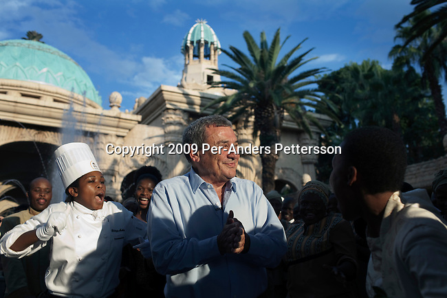 SUN CITY, SOUTH AFRICA – MARCH 31: Sol Kerzner, the South African hotel magnate, is greeted by singing and dancing after arriving at the Palace Hotel on March 31, 2009 in Sun City, South Africa. Mr. Kerzner went to Sun City to see the resort that he built many years ago. Mr. Kerzner has finally returned to SA after spending many years overseas developing hotels. He opened a One&Only Hotel in Cape Town on April 3, 2009. (Photo by Per-Anders Pettersson)