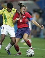 26 August 2004:  Julie Foudy battles for the ball against Formiga of Brazil during the Gold Medal game at Karaiskaki Stadium in Athens, Greece.   USA defeated Brazil, 2-1 in overtime.   Credit: Michael Pimentel / ISI.