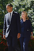 United States President Barack Obama (L) walks down the Colonnade with US Secretary of State Hillary Clinton (R) to deliver remarks on the killing of US ambassador to Libya, Christopher Stevens, and three embassy staff, in the Rose Garden of the White House in Washington DC, USA, 12 September 2012. Gunmen attacked the US consulate in Benghazi, killing Stevens and three others, late 11 September 2012, while another assault took place on the US embassy in Cairo..Credit: Michael Reynolds / Pool via CNP