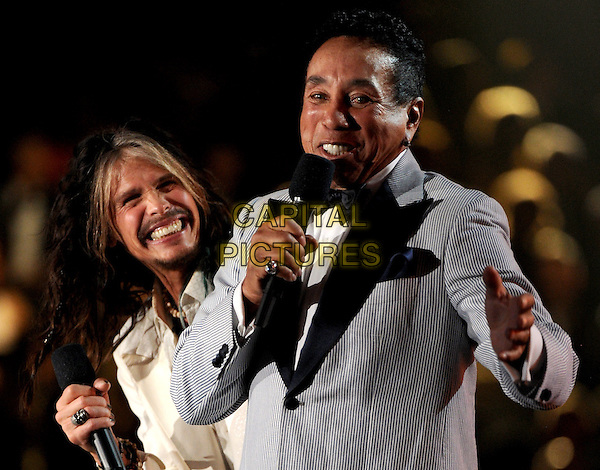LOS ANGELES, CA - JANUARY 26 : (L-R) Steven Tyler and Smokey Robinson speak onstage at The 56th Annual GRAMMY Awards at Staples Center on January 26, 2014 in Los Angeles, California.<br /> CAP/MPI/PG<br /> &copy;PGFMicelotta/MediaPunch/Capital Pictures