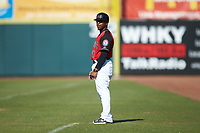 Hickory Crawdads infield coach Joshua Johnson (1) coaches first base during the South Atlantic League game against the Greensboro Grasshoppers at L.P. Frans Stadium on May 26, 2019 in Hickory, North Carolina. The Crawdads defeated the Grasshoppers 10-8. (Brian Westerholt/Four Seam Images)