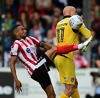 Lincoln City's Nathan Arnold vies for possession with Morecambe's Kevin Ellison<br /> <br /> Photographer Chris Vaughan/CameraSport<br /> <br /> The EFL Sky Bet League Two - Lincoln City v Morecambe - Saturday August 12th 2017 - Sincil Bank - Lincoln<br /> <br /> World Copyright &copy; 2017 CameraSport. All rights reserved. 43 Linden Ave. Countesthorpe. Leicester. England. LE8 5PG - Tel: +44 (0) 116 277 4147 - admin@camerasport.com - www.camerasport.com