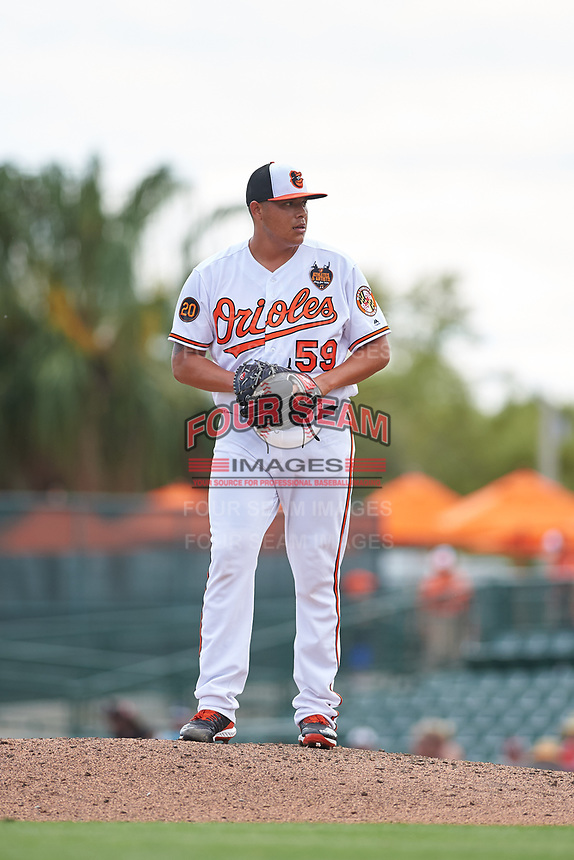 Baltimore Orioles relief pitcher Luis Ortiz (59) gets ready to deliver a pitch during a Grapefruit League Spring Training game against the Tampa Bay Rays on March 1, 2019 at Ed Smith Stadium in Sarasota, Florida.  Rays defeated the Orioles 10-5.  (Mike Janes/Four Seam Images)