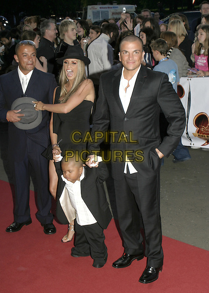 JORDAN - KATIE PRICE, HARVEY & PETER ANDRE.Disney Channel Kids Awards at the Royal Albert Hall.September 17th, 2004.full length, hat, celebrity couple, child, infant, mother, family.www.capitalpictures.com.sales@capitalpictures.com.© Capital Pictures.