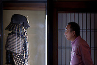 A man looks a suit of samurai armour in the Nomura Samurai house in Kanazawa, Japan Monday October 13th 2008