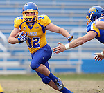 BROOKINGS, SD - APRIL 26:  Kyle Paris #32 from South Dakota State's offense looks for room past the defense during their spring game Saturday at Coughlin Alumni Stadium in Brookings. (Photo by Dave Eggen/Inertia)