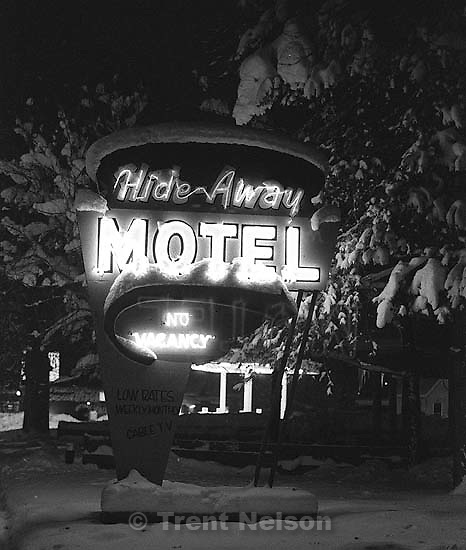 The neon sign in front of the Hideaway Motel.<br />