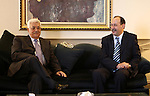 Palestinian President Mahmoud Abbas meets with Deputy Secretary General of  Palestine Liberation Front Bilal Kassem, in The Syrian Capital of Damascus.