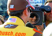 Feb. 27, 2009; Las Vegas, NV, USA; NASCAR Sprint Cup Series driver Kyle Busch is interviewed during qualifying for the Shelby 427 at Las Vegas Motor Speedway. Mandatory Credit: Mark J. Rebilas-