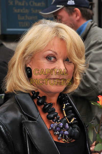 Elaine Paige.Victor Spinetti memorial service.  Memorial service for Welsh actor, best known for his work in theatre and on television, as well as his appearances in The Beatles films. He died in June after battling prostate cancer.  St Paul's (Actors') Church, Covent Garden, London, England..October 2nd, 2012.headshot portrait black jacket leather necklace .CAP/BF.©Bob Fidgeon/Capital Pictures.