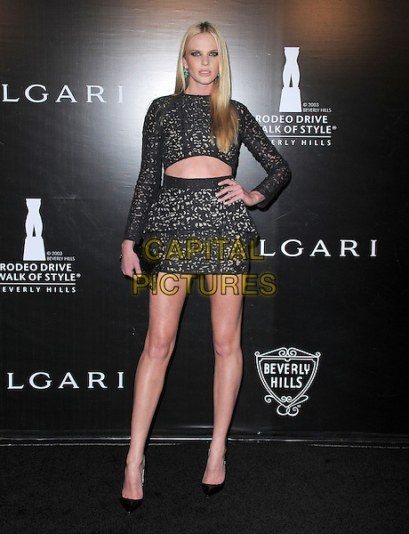 Anne Vyalitsyna (Anne V).Rodeo Drive Walk of Style 2012 held on Rodeo Dr., Beverly Hills, California, USA..December 5th, 2012 .full length black lace crochet pattern top long sleeves peplum  skirt cut out away belly stomach midriff mini hand on hip clutch bag.CAP/DVS.©DVS/Capital Pictures.