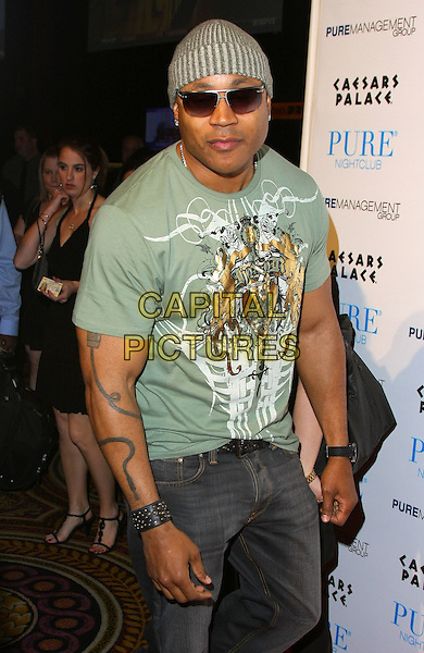 LL COOL J (JAMES TODD SMITH).LL Cool J hosts a night at Pure Nightclub inside the Caesar's Palace Resort Hotel and Casino, Las Vegas, Nevada,.23rd January 2010..half length green beanie hat t-shirt sunglasses tattoo cuff bracelet jeans grey gray print motif .CAP/ADM/MJT.©MJT/Admedia/Capital Pictures