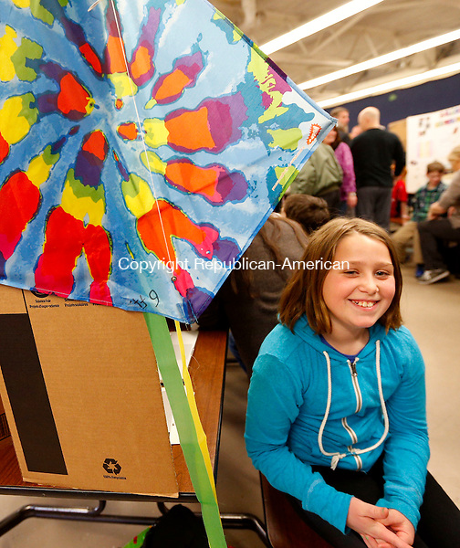 Prospect, CT- 10 April 2015-041015CM01-  Payton Kane, 9, a third grade student at Algonquin School talks about her project during the 20th annual science fair in Prospect on Friday.  Kane's hypothesis was to determine if the tail of a kite would alter it's flying ability.  Kane said that her experiment showed her that the longer the tail, the higher the kite went.  Approximately 100 children participated in the science fair, which included students from five of the school's third graders said Deb Pannone, a third grade teacher at the school.  Pannone added that students used a combination of their  subjects to complete their projects, which they had been working on for two months.  Christopher Massa Republican-American