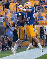 Pitt running back Darrin Hall (22) celebrates his 7-yard touchdown run with Tyler Sear (86). The Pitt Panthers defeated the Syracuse Orange 44-37 in overtime at Heinz Field in Pittsburgh, Pennsylvania on October 6, 2018.
